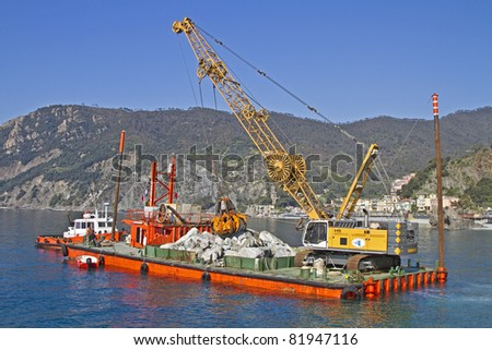 Dredging for his hard work in the Mediterranean - stock photo