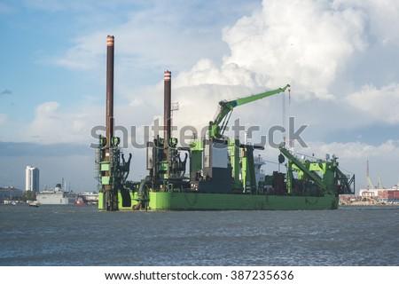 Dredging platform on the sea - stock photo