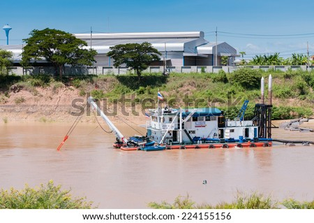 Dredging ship in the river - stock photo