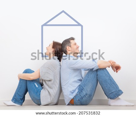 dreeaming of new home at home lovers - stock photo