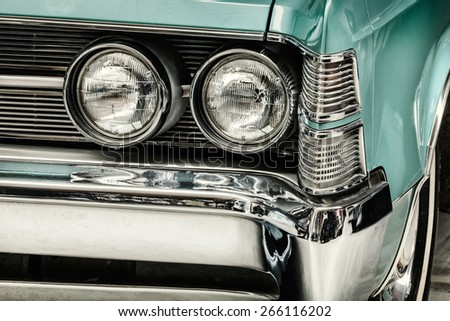 DREMPT, THE NETHERLANDS - MARCH 30, 2015: Retro styled image of the front of a classic 1967 Chrysler New Yorker in Drempt, The Netherlands - stock photo