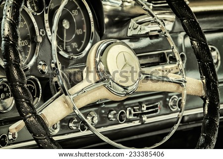 DREMPT, THE NETHERLANDS - NOVEMBER 19, 2014: Retro styled image of the dashboard of a 1960 Mercedes-Benz 190 SL Pagode in Drempt, The Netherlands - stock photo