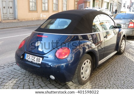 DRESDEN, GERMANY - CIRCA MARCH 2016: blue Volkswagen New Beetle cabrio car parked in a street of the city centre - stock photo