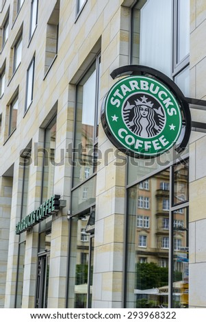 """DRESDEN, GERMANY - JUNE 07: the logo of the brand """"STARBUCKS"""" on a Starbucks Coffee House in Old Town of Dresden on Jun 07 2015 in Dresden - stock photo"""