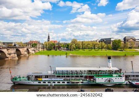 DRESDEN, GERMANY - MAY 12, 2013: Cityscape of old Dresden, Ferry on the Elbe River, Germany - stock photo