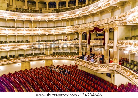 DRESDEN, GERMANY - MAY 5: Semper Opera from inside with tourists on May 5,2008 in  Dresden, Germany.he opera house was originally built by the architect Gottfried Semper in 1841.