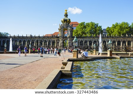 DRESDEN, GERMANY - SEPTEMBER 19, 2015: Crown Gate (Kronentor) of Zwinger, an impressive Baroque gate in a long arched gallery, a large crown on top of the gate is decorated with gilded motifs - stock photo