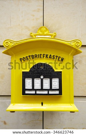 DRESDEN, GERMANY - SEPTEMBER 19, 2015: Painted yellow mailbox from the Federal Post Office is currently used by Deutsche Post AG - stock photo