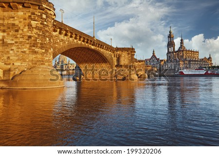 Dresden. Image of Dresden, Germany with Albert Bridge illuminated with golden light. - stock photo