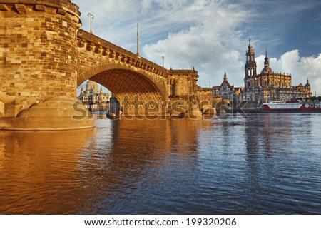 Dresden. Image of Dresden, Germany with Albert Bridge illuminated with golden light. - stock photo