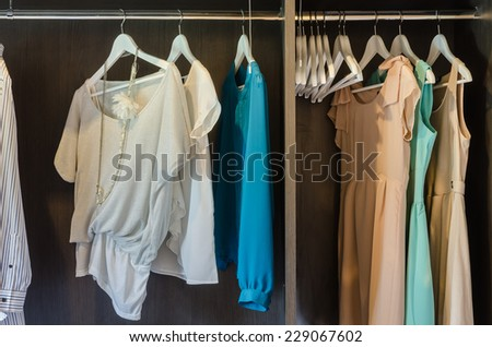 dress hang in wooden wardrobe at home