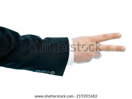 Dressed in a business suit caucasian male hand gesture of a number two or a victory sign, high-key light composition isolated over the white background - stock photo