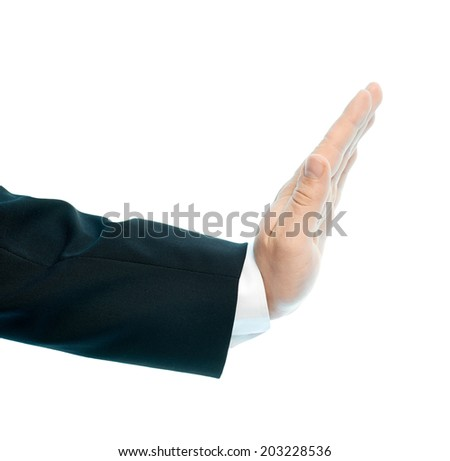 Dressed in a business suit caucasian male hand stop sign gesture of an opened palm, high-key light composition isolated over the white background - stock photo