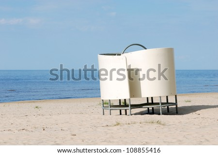 Dressing cabin on the beach - stock photo