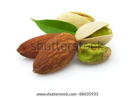 Dried almonds and pistachio with leaves