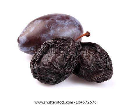 Dried and fresh plums - stock photo