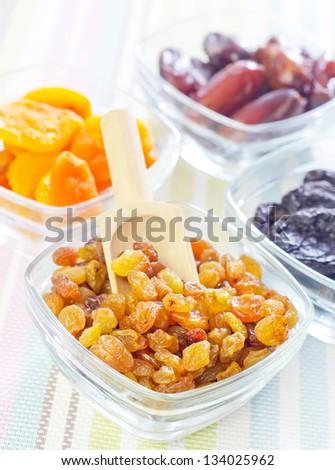 dried apricots, raisins and dates - stock photo