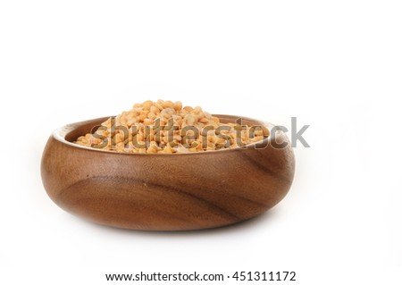 Dried beans peas in a wooden bowl on a white background. ingredient for a healthy lifestyle and diet. - stock photo