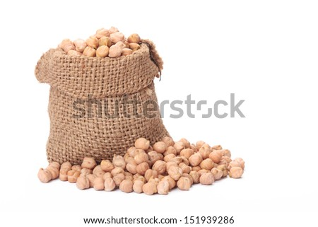 dried chickpea in burlap sack - stock photo