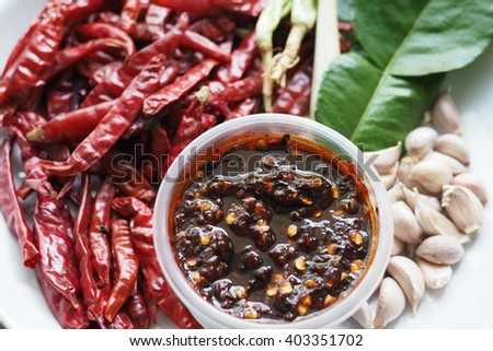 dried Chili And Chili Paste with garlic kaffir lime leaves and lemon grass - stock photo