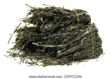dried, chopped, green seaweed on white background  - stock photo