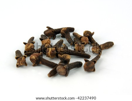 dried cloves on white background