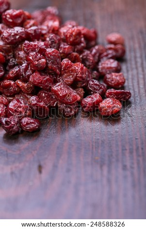 dried cranberries in a bowl ,fruit full of vitamin c. - stock photo