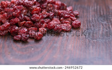 dried cranberries on old wooden background.fruit full of vitamin c.  - stock photo