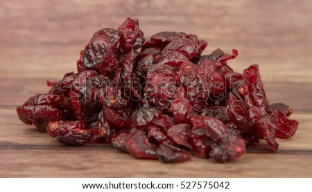 Dried cranberries over wooden background