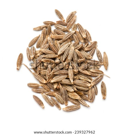 Dried cumin seeds pile isolated on white background - stock photo