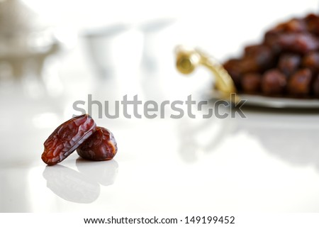 Dried dates and Arabic coffee are a prominent feature of the hospitality to be expected in Arabia - stock photo