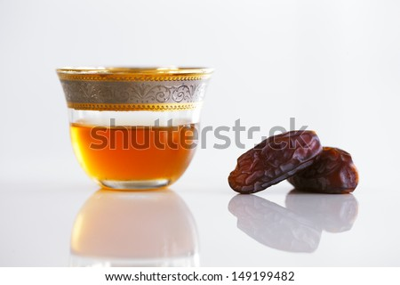 Dried dates and Arabic tea are a prominent feature a typical welcome be expected in Arabia - stock photo