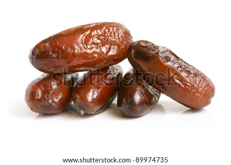 Dried dates on a white background - stock photo