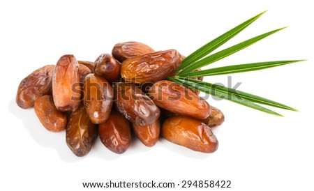 Dried dates with green leaf isolated on white background - stock photo