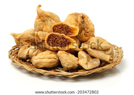 dried fig on white background  - stock photo