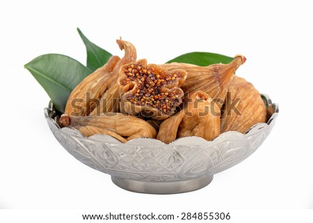 Dried figs in a silver plate - stock photo