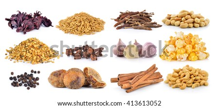Dried figs, pepper corn, chili seeds, Spice cloves, rice grains, Dried okra, cashewnuts, peanuts, garlic, PopCorn, cinnamon on white background
