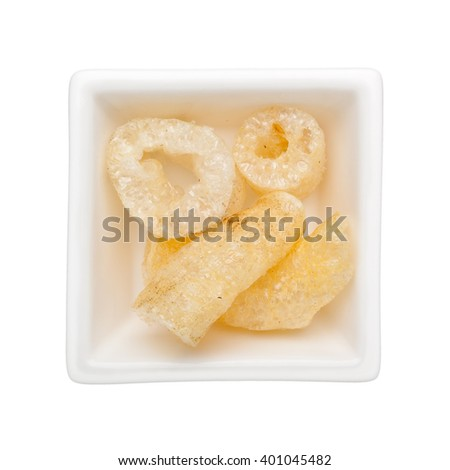 Dried fish maw in a square bowl isolated on white background