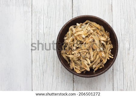 Dried fish on wooden Bowl - stock photo