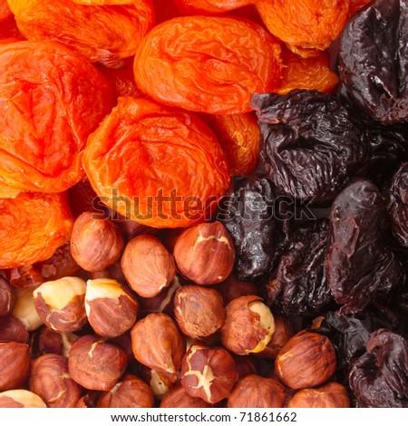 Dried fruits and hazelnuts backgtound - stock photo