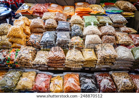 Dried fruits and nuts for sale at Gwangjang Market in Seoul, South Korea. - stock photo
