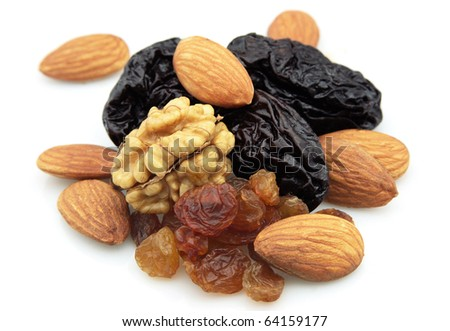 Dried fruits and nuts on a white background - stock photo