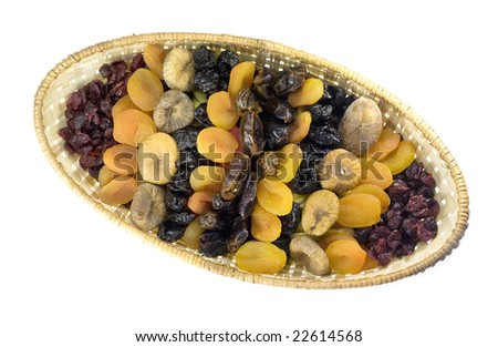Dried fruits arranged in a basket - top view - stock photo