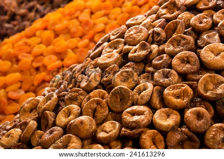 Dried fruits: figs and apricots at moroccan market in Marrakesh - stock photo