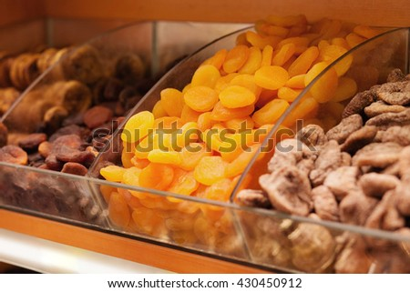 Dried fruits. Focus on apricots. Closeup picture - stock photo