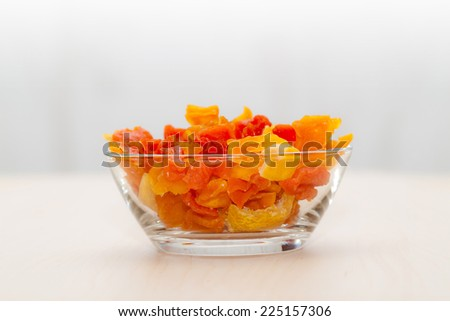 Dried fruits in plate isolated on white (shallow DOF) - stock photo