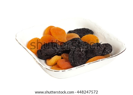 Dried fruits  in white bowl isolated on white - stock photo