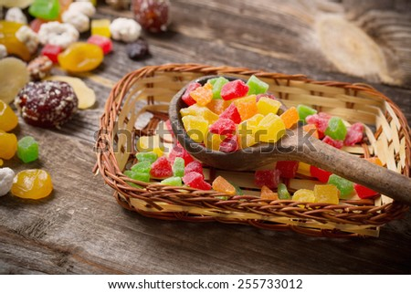 dried fruits mix on wooden background - stock photo