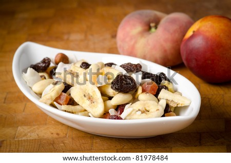 dried fruits on a white plate - stock photo