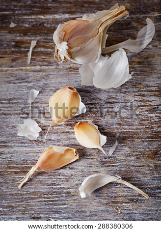 Dried garlic on a wooden surface - stock photo